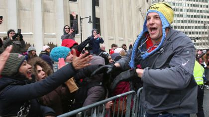 Tight end Rob Gronkowski of the New England Patriots high fives fans. (Photo by Billie Weiss/Getty Images)