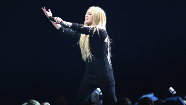 Avril Lavigne performs onstage during 103.5 KISS FMÂ's Jingle Ball 2013, presented by Jam Audio Collection, at United Center on December 9, 2013 in Chicago, IL.  (Photo by Daniel Boczarski/Getty Images)