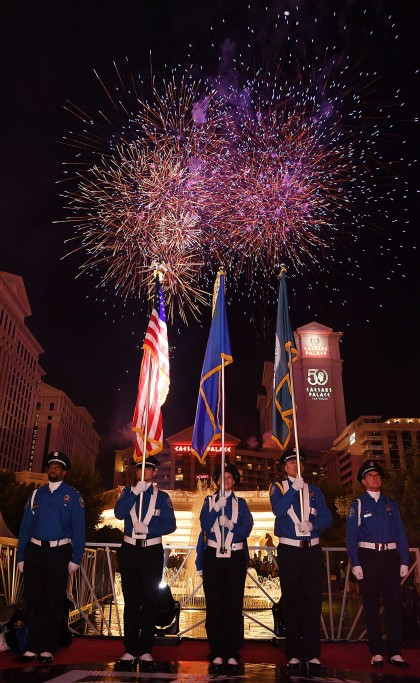 LAS VEGAS, NV - JULY 03: TSA Color Guard during the fireworks display over Caesars Palace in celebration of the resort's 50th anniversary on July 3, 2016 in Las Vegas, Nevada. (Photo by Denise Truscello/Getty Images for Caesars Entertainment ) *** Local Caption *** TSA Color Guards