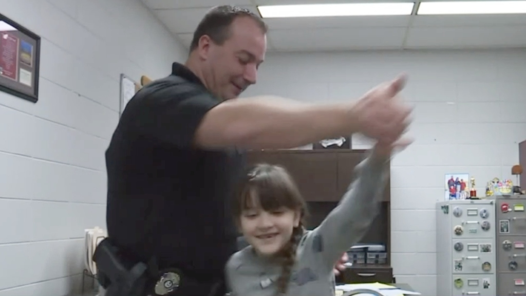 Officer Escorts 8-Year-Old Girl To Father-Daughter Dance After Her Dad Dies